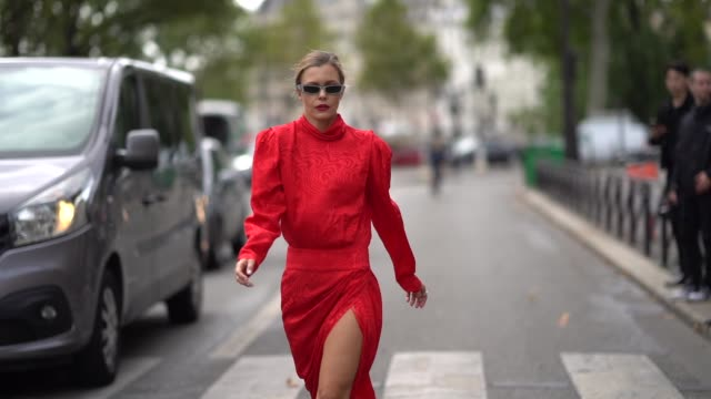 elizabeth sulcer wears a red damask dress, blue sandals, sunglasses, outside redemption, during paris fashion week - womenswear spring summer 2020 on... - fashion week stock videos & royalty-free footage