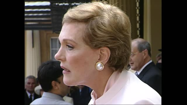 elizabeth taylor and julie andrews made dames: interviews; england: london: buckingham palace: julie andrews interview sot andrews stands holding... - autographing stock videos & royalty-free footage