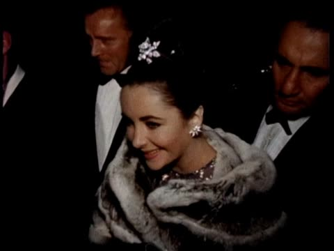 elizabeth taylor and richard burton movie premiere the spy who came in from the cold hollywood movie premiere at the warner hollywood theater in 1965 - film premiere stock videos & royalty-free footage