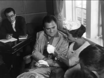 elizabeth taylor + mike todd sitting + talking with reporters at press conference / newsreel - 1957 stock videos & royalty-free footage