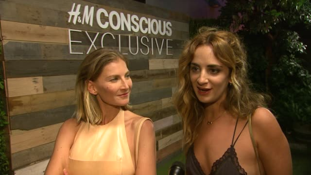 elizabeth von guttman, alexia niedzielski on collaborating with h&m, how it feels to see the project come to fruition, why a sustainable fashion... - interview raw footage stock videos & royalty-free footage