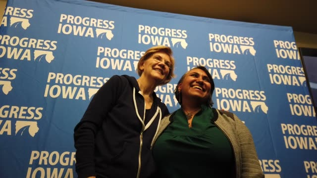 elizabeth warren poses for photos at democratic presidential candidate sen elizabeth warren campaigns in iowa days before state's caucus on february... - iowa stock videos & royalty-free footage