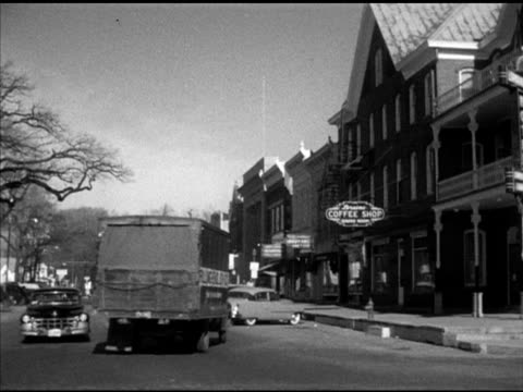 Elkhorn city VS Main Street in Elkhorn w/ some traffic shops The Elkhorn Independent editor Claude Eames exiting newspaper shop Elkhorn residents...