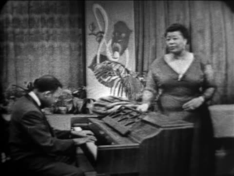 ella fitzgerald singing between the devil deep blue sea / the larry finley show - ella fitzgerald stock videos & royalty-free footage