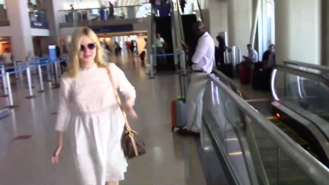 elle fanning arriving at lax airport in los angeles in celebrity sightings in los angeles, - candid stock videos & royalty-free footage