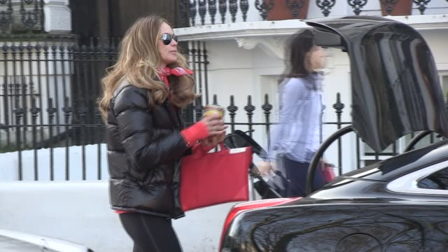 elle macpherson sighted in west london taking her child to school. sighted: elle macpherson on march 24, 2011 in london, england - school child stock videos & royalty-free footage
