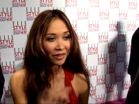 arrivals / interviews mylene klass arrival with man mylene klass interview sot celebrity style likes individuality/ on size zero models if that is... - red dress stock videos & royalty-free footage