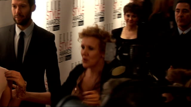 elle style awards 2011: red carpet interviews; gvs minnie driver posing for and talking to press / emma watson posing for press / watson talking to... - minnie driver stock videos & royalty-free footage