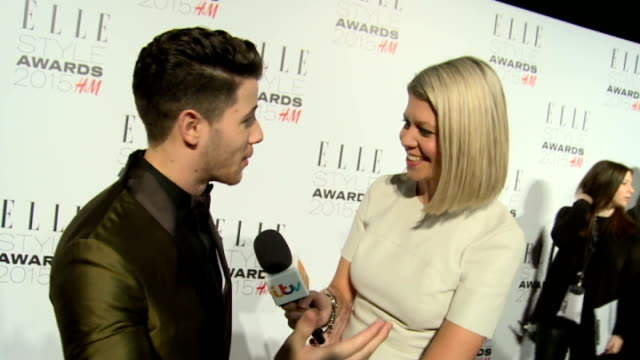Elle Style Awards 2015 red carpet interviews Nick Jonas posing on red carpet / Alexa Chung chatting to press / Lewis Hamilton posing on red carpet /...