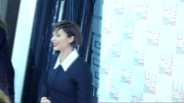 Arrivals and interviews ****FLASH Actress and singer Natalie Imbruglia posing for photocall along and with designer Erdem