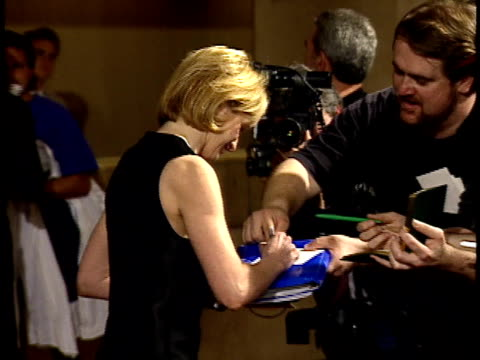vídeos de stock, filmes e b-roll de ellen barkin signing fan autographs on red carpet - american film institute