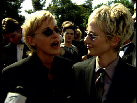 ellen degeneres and anne heche talk to reporters on the red carpet at the 50th annual emmy awards. - anne heche stock videos & royalty-free footage