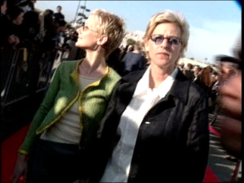 ellen degeneres and anne heche walking the red carpet at the 1998 mtv movie awards. - anne heche stock videos & royalty-free footage