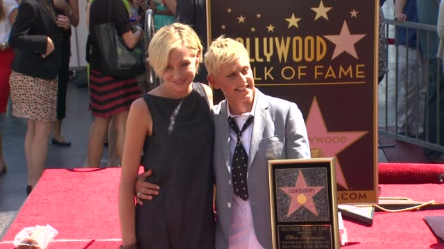vídeos y material grabado en eventos de stock de ellen degeneres and portia de rossi at ellen degeneres honored with star on the hollywood walk of fame ellen degeneres and portia de rossi at ellen... - ellen degeneres