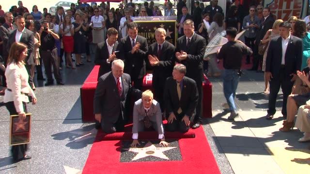 stockvideo's en b-roll-footage met ellen degeneres, ryan seacrest, and jimmy kimmel at ellen degeneres honored with star on the hollywood walk of fame ellen degeneres, ryan seacrest,... - jimmy kimmel