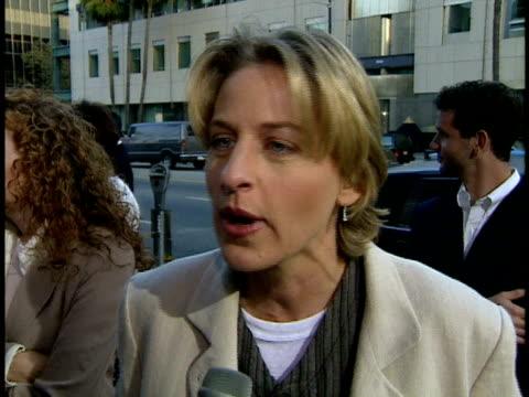 ellen degeneres talks to reporter about jim carrey on red carpet - ellen degeneres stock-videos und b-roll-filmmaterial