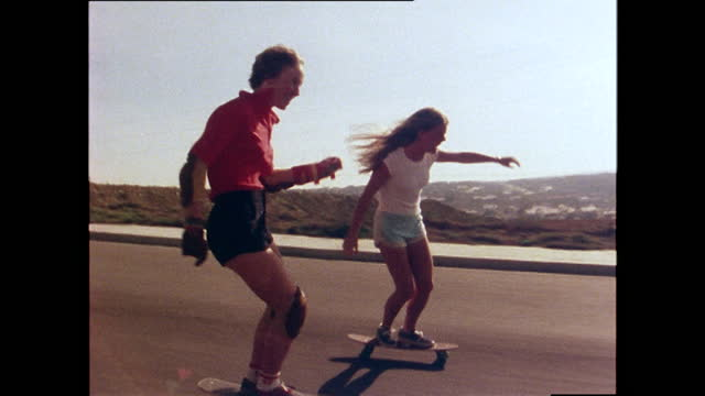 ellen o'neal, professional skateboarder, skateboards with another female skateboarder; 1978. - young women stock videos & royalty-free footage