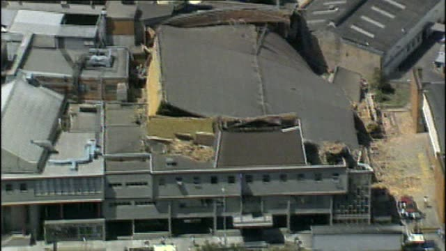 vídeos de stock, filmes e b-roll de chris reason news reading/ file aftermath of newcastle earthquake aerial of partially collapsed building / pan across street showing collapsed... - moving activity