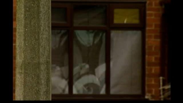 vídeos de stock, filmes e b-roll de ellie lawrenson killed by pit bull terrier: grandmother found not guilty of manslaughter; tx 1.1. 2007 st helens: ext incident tent outside house... - terrier