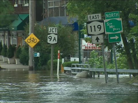 elmsford new york flooding hurricane irene aftermath. wide shot of heavily flooded streets and rippling water. hurricane irene of 2011 was an... - hurricane irene stock videos & royalty-free footage