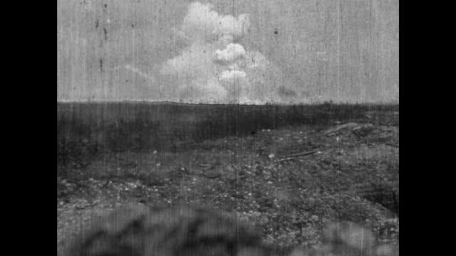 elss of battlefield at arras, shells exploding, cameronian soldiers racing across no man's land during raid on german trenches. - ww1 battle stock videos & royalty-free footage