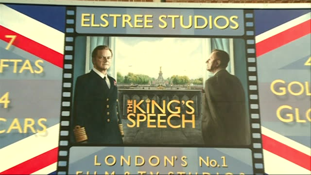 elstree studios general views; masks and busts in studio with people working on creations / 'the king's speech' poster / 'star wars' poster / framed... - ボーハムウッド点の映像素材/bロール