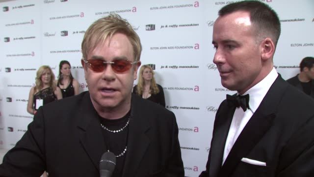 Elton John and David Furnish at the 17th Annual Elton John AIDS Foundation Academy Award Viewing party at Los Angeles CA