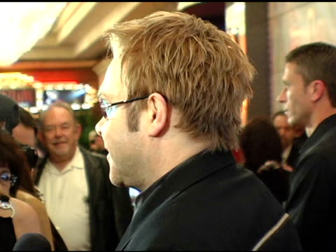 elton john at the 'barry manilow: music and passion' opening night at the las vegas hilton hotel in las vegas, nevada on february 24, 2005. - ラスベガスヒルトン点の映像素材/bロール