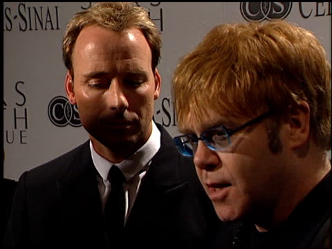 elton john at the sir elton john's an unforgettable evening at the regent beverly wilshire hotel in beverly hills, california on march 26, 2002. - regent beverly wilshire hotel stock videos & royalty-free footage