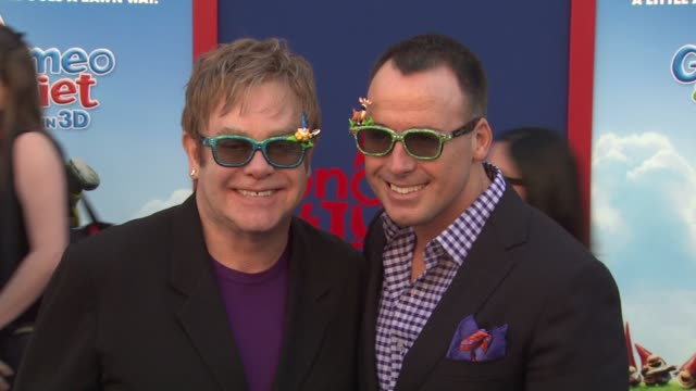 elton john, david furnish at the 'gnomeo & juliet' premiere at los angeles ca. - film premiere stock videos & royalty-free footage
