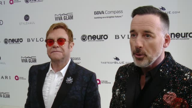 INTERVIEW Elton John David Furnish on the event at 25th Annual Elton John AIDS Foundation's Academy Awards Viewing Party in Los Angeles CA