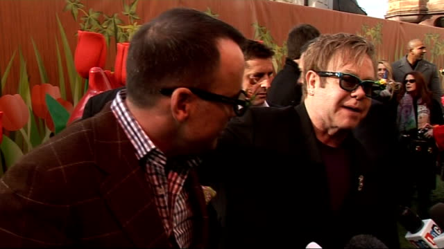 Elton John defends his decision to become a father at 63 / 'Gnomeo and Juliet' film Central London EXT Elton John and David Furnish at photocall for...
