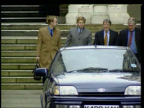 Elton John loses court case LIB London Sir Elton John towards leaving court with partner David Furnish