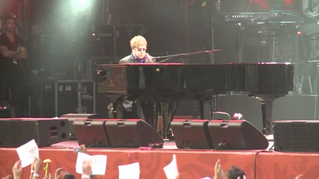 elton john takes to the stage in the kiev fanzone for a benefit concert to raise awareness against hivaids kiev ukraine - benefit concert stock videos & royalty-free footage
