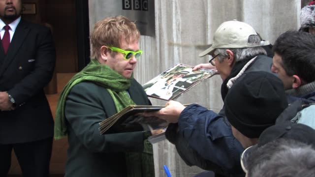 elton john visits radio two to play an ultra-intimate gig for bbc employees in the lobby of their studios which is broadcast on bbc radio two.... - bbc radio stock videos & royalty-free footage