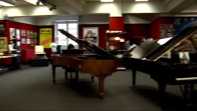 elton john's grand piano to be auctioned; england: london: knightsbridge: bonhams auctioneers: int exhibition of music memorabilia on display in... - ringo starr stock videos & royalty-free footage
