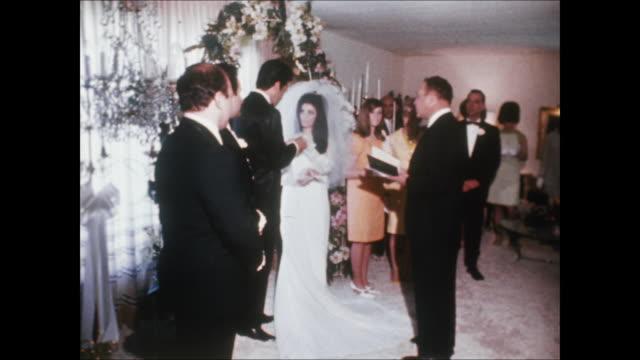 elvis and priscilla exchange vows at their wedding. elvis and priscilla were married on may 1 at the aladdin hotel in las vegas. hdcam-sr at... - プリシラ プレスリー点の映像素材/bロール