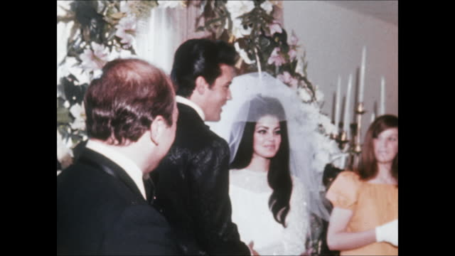 elvis and priscilla kiss at their wedding, elvis and priscilla were married on may 1 at the aladdin hotel in las vegas. hdcam-sr at 23.98fps: hd... - プリシラ プレスリー点の映像素材/bロール