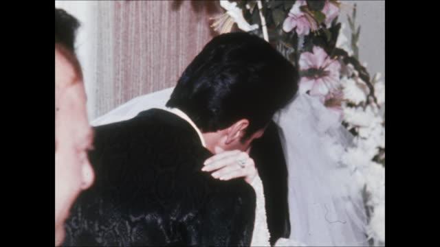 elvis and priscilla kiss during their wedding. elvis and priscilla were married on may 1 at the aladdin hotel in las vegas. hdcam-sr at 23.98fps: hd... - プリシラ プレスリー点の映像素材/bロール