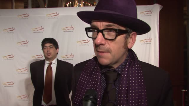 elvis costello talking about being at the event and supporting the cause. at the 'a funny thing happened on the way to cure parkinson's' benefit at... - elvis costello stock-videos und b-roll-filmmaterial