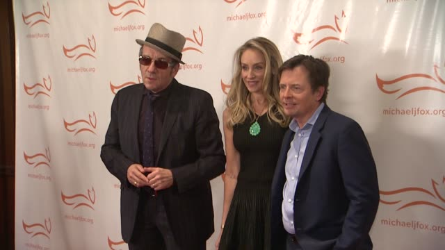 elvis costello tracy pollan and michael j fox at a funny thing happened on the way to cure parkinsons at the waldorf astoria hotel on november 10... - michael j. fox stock videos and b-roll footage