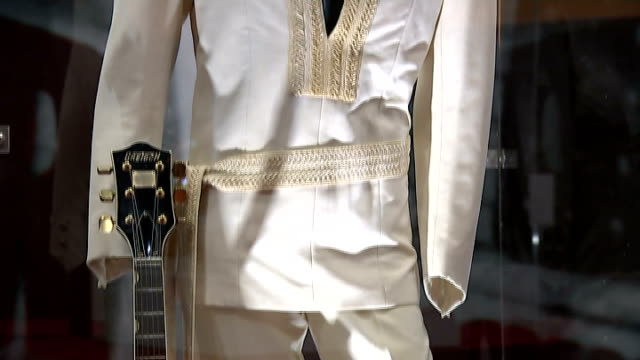 elvis presely exhibition at the o2 keyring with the name lisa on various of autographed champagne bottle and cufflinks on display costume and guitar... - cufflink stock videos & royalty-free footage