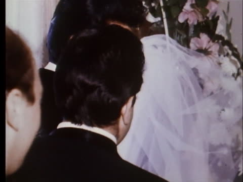 elvis presley and priscilla beaulieu exchange rings and vows during their wedding ceremony. - プリシラ プレスリー点の映像素材/bロール