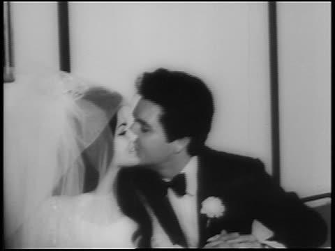 elvis presley kissing priscilla on cheek after wedding / las vegas / newsreel - プリシラ プレスリー点の映像素材/bロール