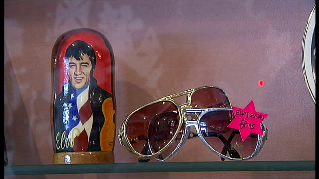 elvis presley may have secretly visited london in 1958 baker street int sid shaw putting elvis presley souvenirs on shelves inside his gift shop... - お土産点の映像素材/bロール