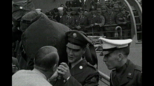elvis presley may have secretly visited london in 1958 s23030702 bremerhaven ext b/w footage elvis presley down gangway of ship fans running forward... - whistling stock videos & royalty-free footage