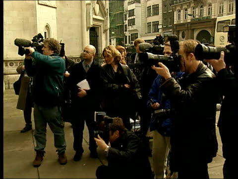 court battle ben helen england london the strand ext sid shaw who sells elvis presley memorablia posing with elvis presley looalike outside court... - the strand london stock videos and b-roll footage