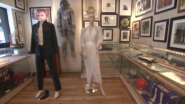 """vidéos et rushes de elvis presley owned and worn blue suede shoes signed & inscribed """"to gary pepper"""" and princess diana worn zandra rhodes white chiffon evening dress... - rock moderne"""
