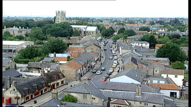 ely cathedral service held; itn tgv rooftops of soham tlgv st andrew's church pull out - wells cathedral stock videos & royalty-free footage