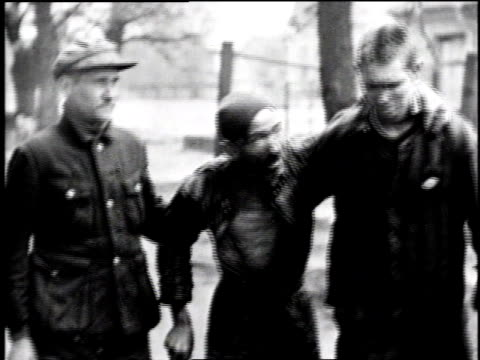 ms emaciated prisoner being helped to walk by another prisoner and former german guard / cu emaciated prisoner talking / lower saxony germany - holocaust stock videos & royalty-free footage